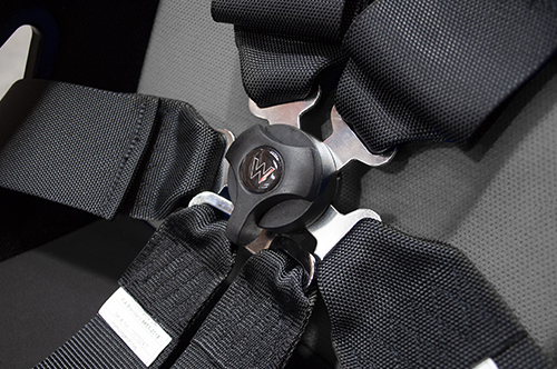 6-Point-Race-Harness-FIA-Buckle-Close-Up-black-on-bucket-seat